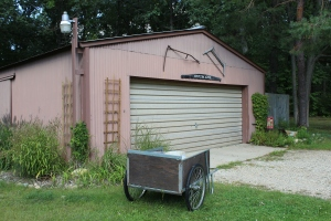 Cart in front of barn