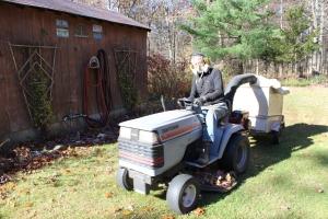 Gene on tractor behind pool shack