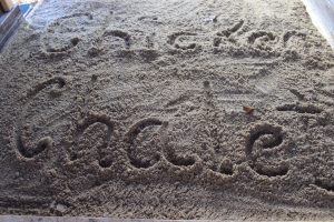 Chicken Challet written in sand
