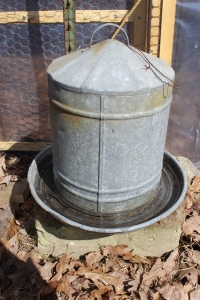 Close up of galvanized waterer