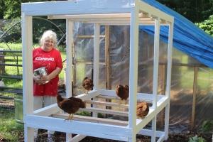 Donna smiling chicks on frame USE