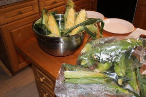 Corn in bowl and bags on chopping block