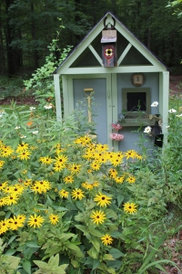 Black eyed susans in front of playhouse USE