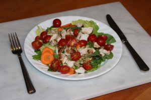 Chicken sald with silverware USE