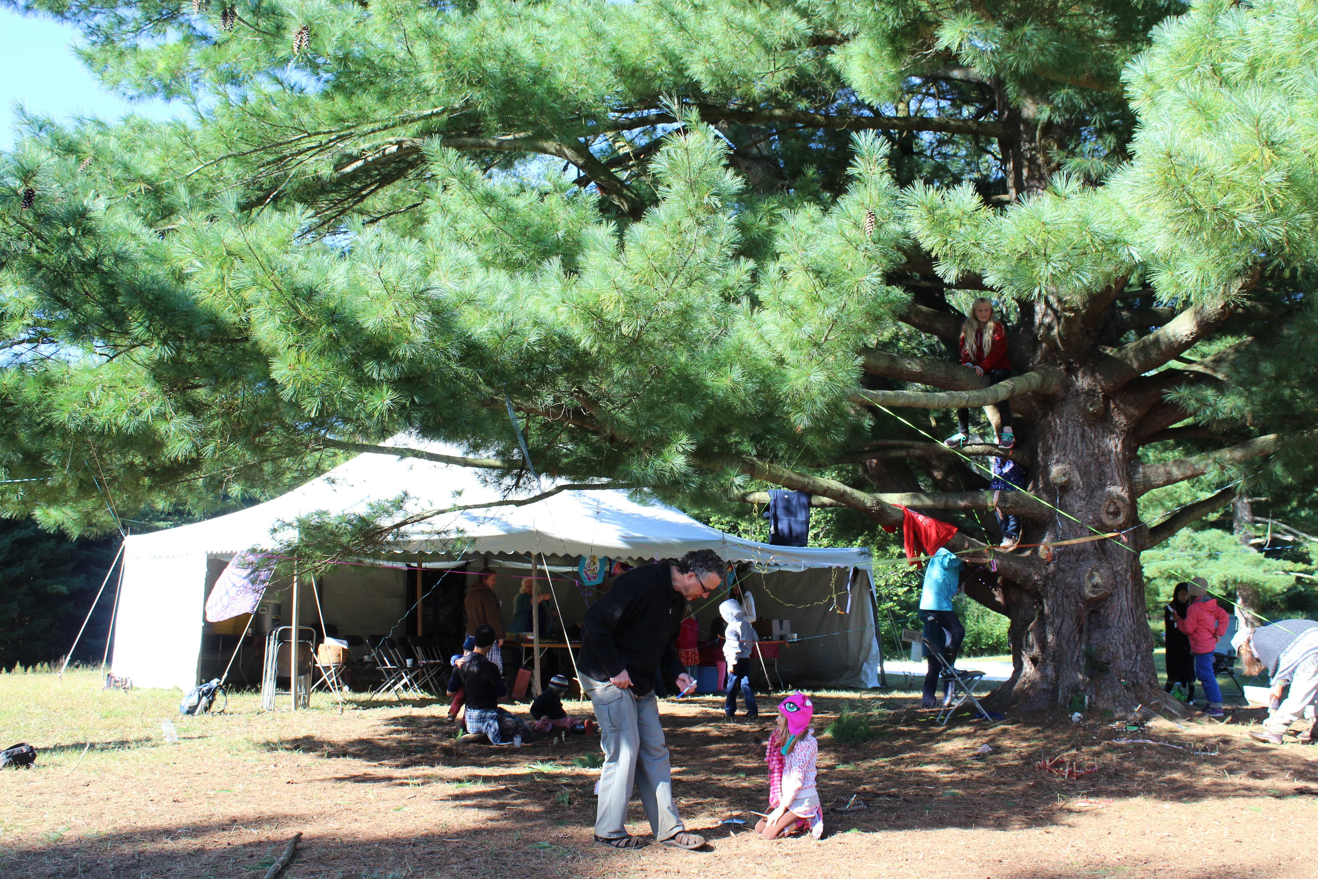 Dad child tent and tree USE & Great Lakes Herb Faire | Small House Big Sky Homestead