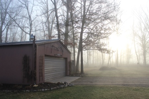 Barn sun rising in fog